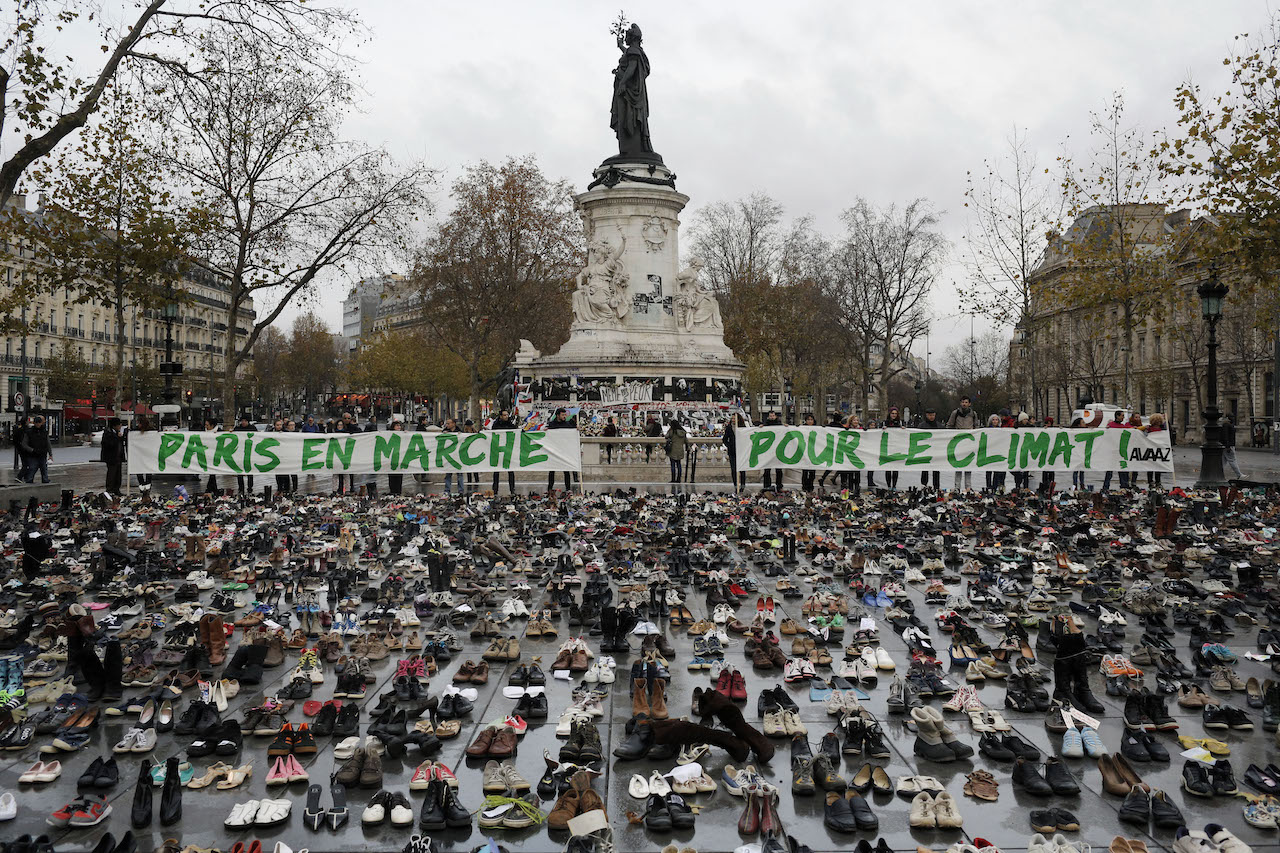 "Hundreds of pairs of shoes are displayed at the place de la Republique, in Paris, as part of a symbolic and peaceful rally called by the NGO Avaaz ""Paris sets off for climate"", Sunday, Nov. 29, 2015.  More than 140 world leaders are gathering around Paris for high-stakes climate talks that start Monday, and activists are holding marches and protests around the world to urge them to reach a strong agreement to slow global warming. (AP Photo/Laurent Cipriani)"