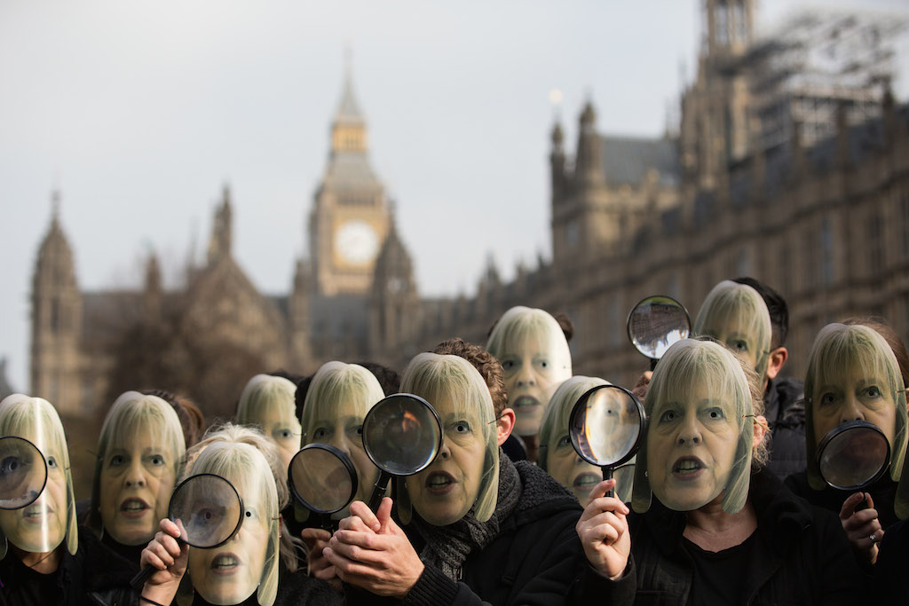 Campaigners from NoteMyVote.couk protest the lack of transparency around the proposed Investigatory Powers Bill outside the Houses of Parliament