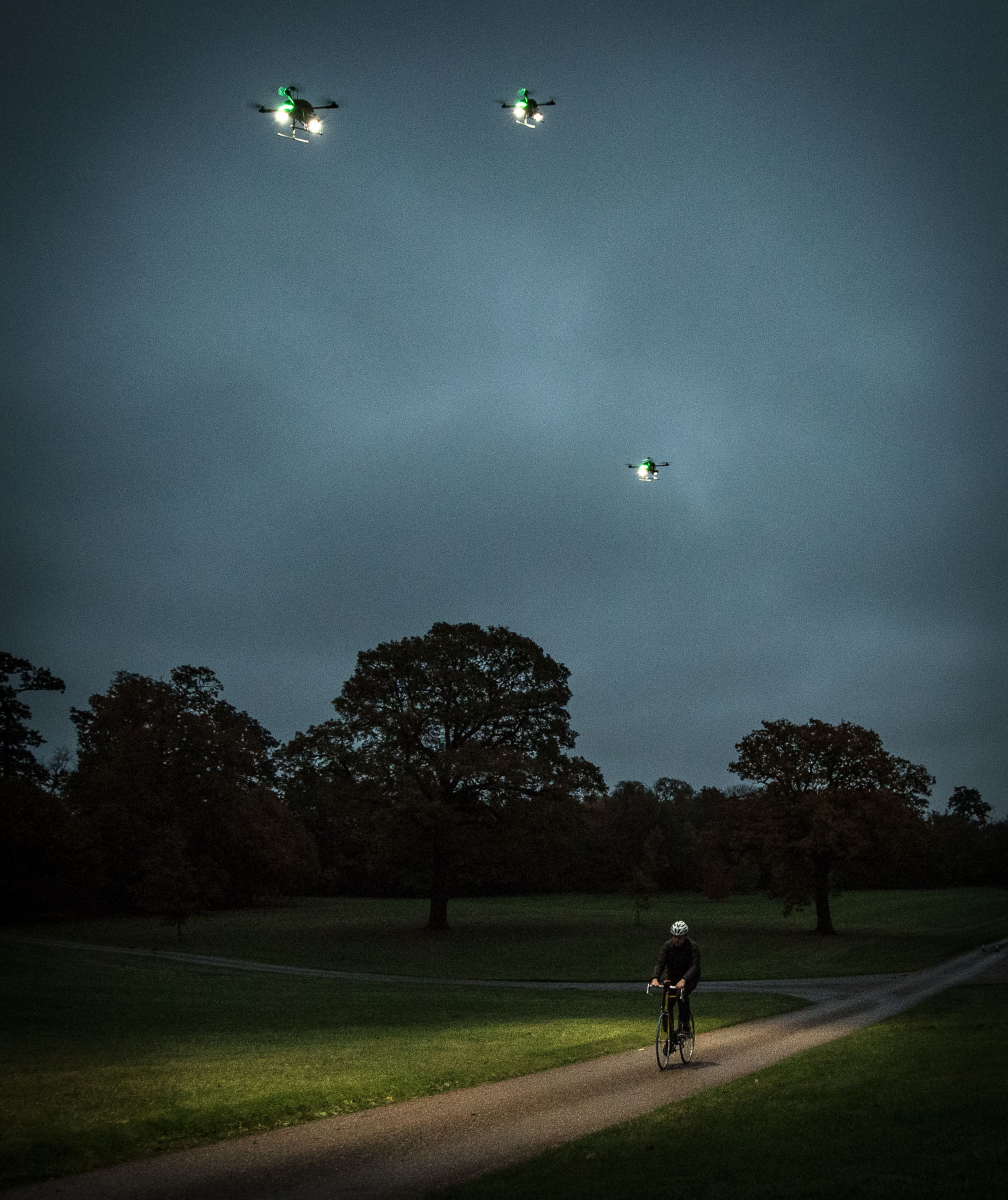 EMBARGOED TO 0001 WEDNESDAY NOVEMBER 16 EDITORIAL USE ONLY Cyclist Matt Ritz Wright during the launch of ÔFleetlightsÕ Ð a prototype range of smart drones fitted with high-powered lights, which have been designed by Direct Line and can be ordered by phone to improve road and pedestrian safety at night, at Borehamwood, Hertfordshire. PRESS ASSOCIATION Photo. Issue date: Wednesday November 16, 2016. The insurance provider has partnered with the drone technology specialists behind Mission Planner to create the prototype Fleetlights mobile phone app, which makes it simple to control the service and track your journey using your GPS location. The software is the first time the ÔLight my WayÕ functionality - which tracks and maintains a fixed distance ahead of a subject, rather than behind - has been used. Photo credit should read: John Nguyen/PA Wire